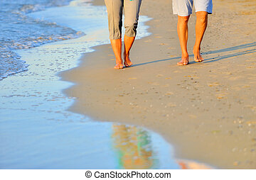 Close-up of a romantic couple along the beach