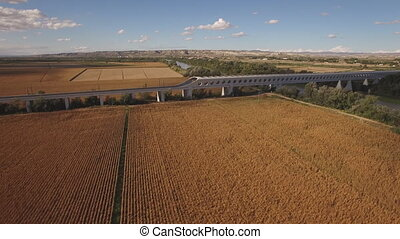 Descending over corn field with railway bridge - Flying over...