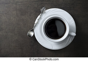 Cup of coffee on wooden  dark table