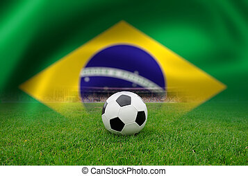 Soccer ball on the field of stadium on Brazil flag...