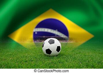 Soccer ball on the field of stadium on Brazil flag...