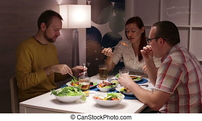 Family eating at the table and talking