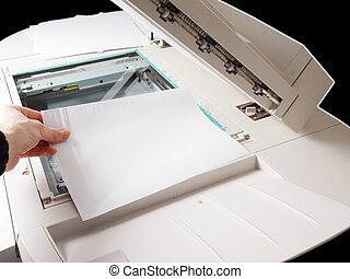 Copier - A person handling a multi purpose copier machine
