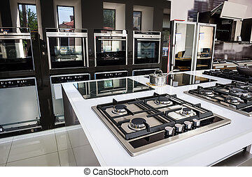 Brand new gas stoves - Rows of gas stoves with stainless...