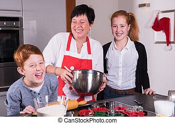 mother and children preparing christmas bakery