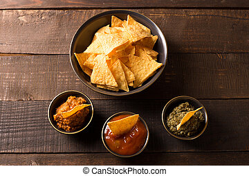 tortilla chips - top view of tortilla chips with various...