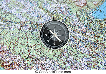 Map and compass. Magnetic compass is located on a...