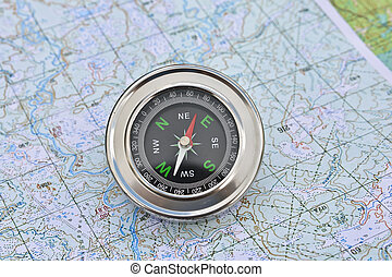Map and compass Magnetic compass is located on a topographic...