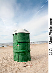 Public WC on the Beach - Green plastic portable toilet in...