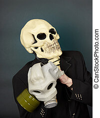 Man in a mask of death puts gas mask