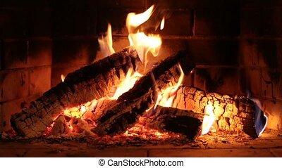 Real fireplace closeup with flame