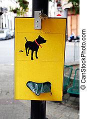 Dog poop bag dispenser - Yellow plastic bag dispenser for...