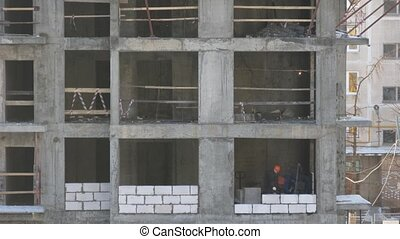 blocks on building construction and sunspots, time lapse -...
