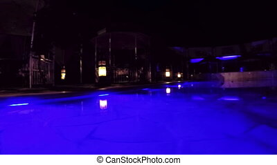 Night illuminated pool - Dolly shot Changing colored lights...
