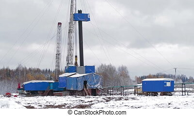Oil Drilling rig Winter - Drilling rig. Hard work in winter