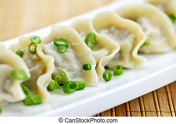 Plate of dumplings - Plate of cooked chinese dumplings in a...