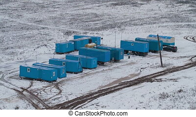 Aerial view on mobile houses of drilling crew - Aerial view...