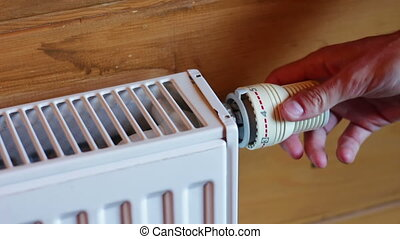Heating Radiator Turn On and Off - Hand of a man turning...