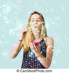 Creative woman blowing birthday party bubbles - Creative...