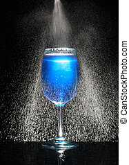 Glass with fresh icy water in motion - Blue glass with fresh...