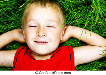 Happy dreaming child on fresh grass - Happy dreaming child...