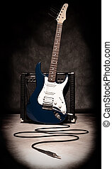 electric guitar and amplifier on dark background, sepia...