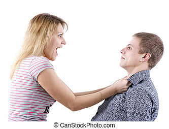 woman abusing a man - young woman abusing a man holding him...