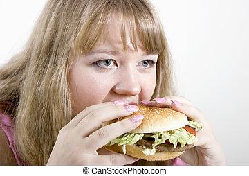 The young woman and hamburger