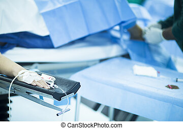 Patient hand in hospital operating room surgery - Patient...