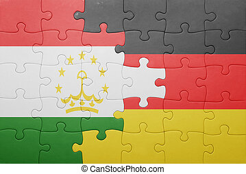 puzzle with the national flag of germany and tajikistan....