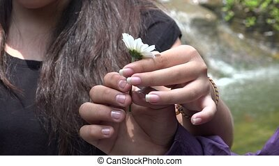 Teen Girl Holding Daisy Flower