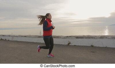 Runner woman running seaside. athlete fitness silhouette...
