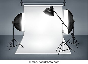 Photo studio with lighting equipment flash spotlight and...