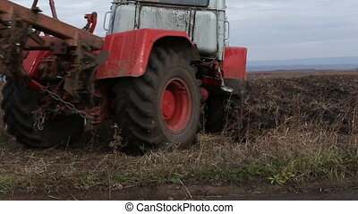Tractor plowing land