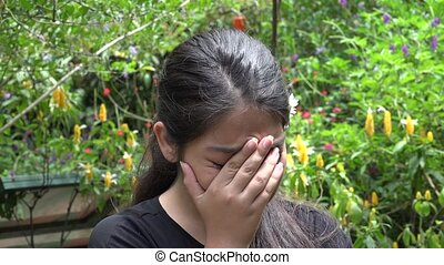 Sad Hispanic Teenage Girl