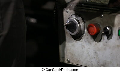 operator turns the handle to move the cutter close-up
