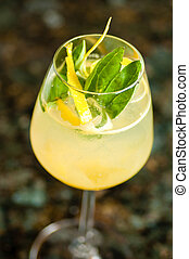 close-up of one misty wine glass filled with yellow...