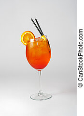 glass filled with orange colored cocktail - front close-up...