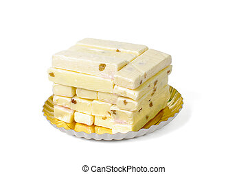 bars of white fudge stacked on plate - close-up of a stack...