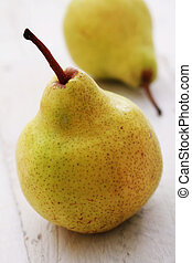 fresh pear fruit on wood background