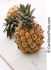 dwarf mini pineapple on wooden background