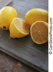 fresh sliced lemons on chopping board