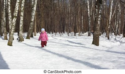 Small girl runs in wood
