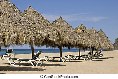 Beach palapas by the Mexican Pacific Ocean in Lo de Marcos,...
