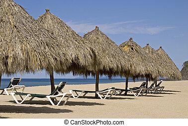 Beach palapas by the Mexican Pacific Ocean in Lo de Marcos,...