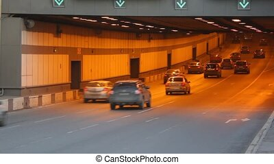 Cars move in tunnel