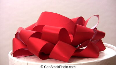 Red bow on revolving box