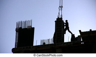 Silhouette worker on construction site