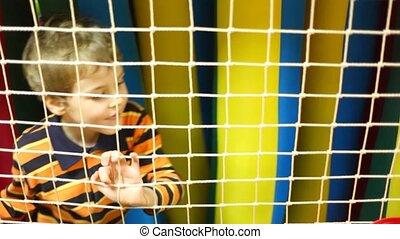 Boy goes beside nets