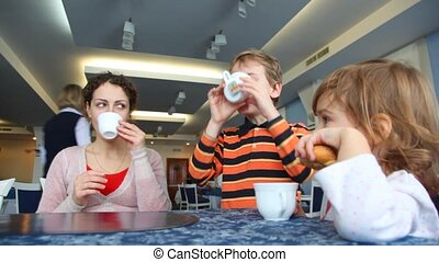 Mother and two children lunch in cafe